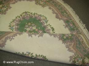 Comparing the back and the front of the rug.