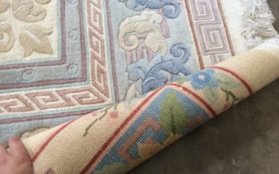 Why do some wool rugs fade?