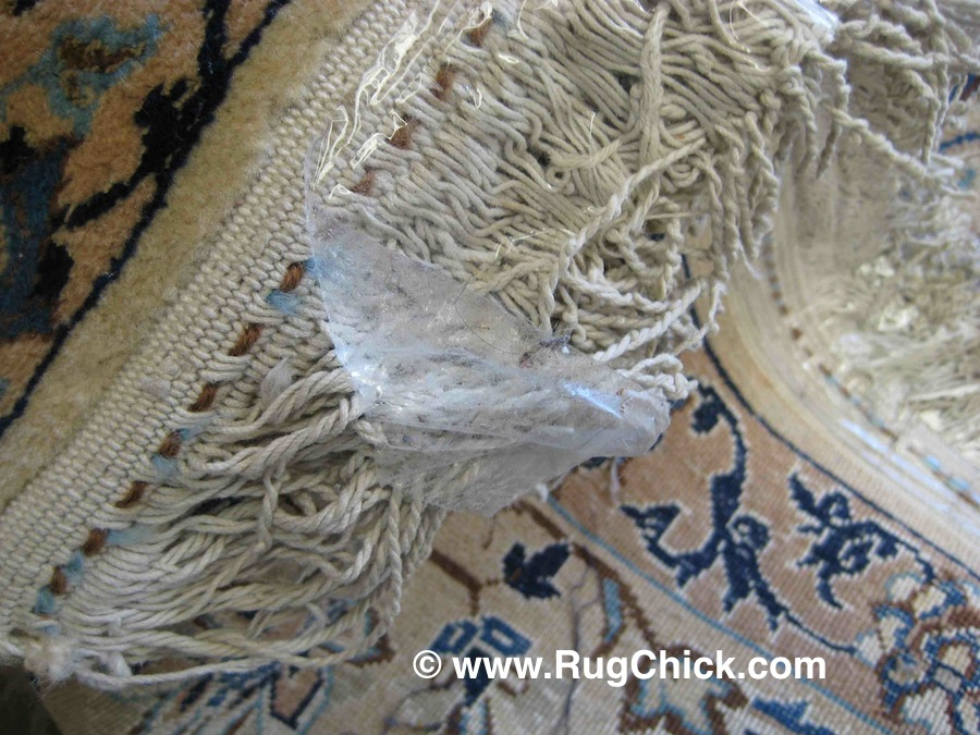 Clear packing tape on rug fringe