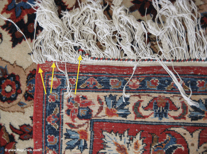 The decorative braid is sliding away from this Persian rug
