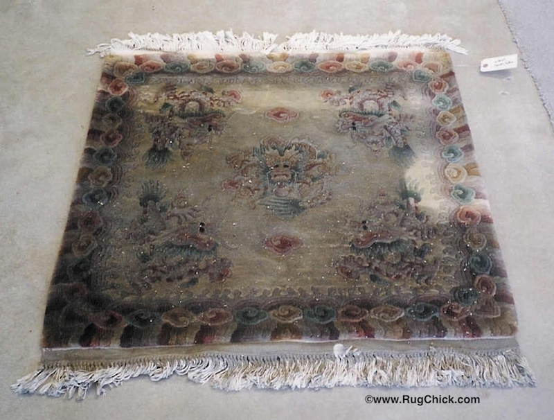 Heavier smoke/soot damage to a Chinese wool rug.