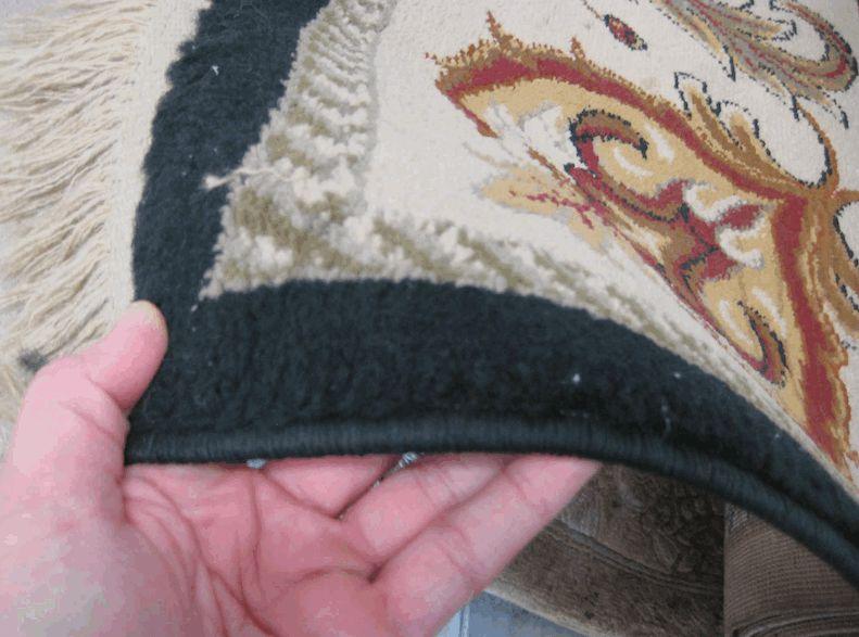 """Blah"" looking acrylic rug. Flat colors. Texture looks like a sponge."