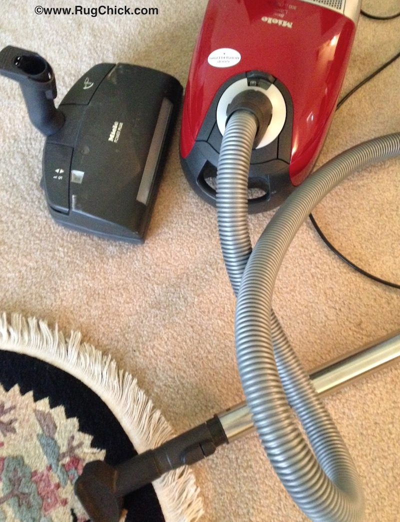 My Miele vacuum. I use it on floors, carpeting, and my woven rugs.
