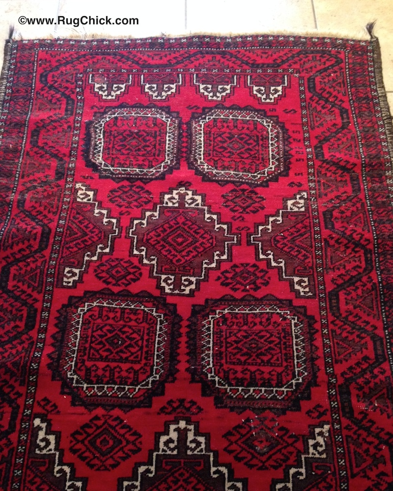 This rug has some buckling/wrinkles that are often present in tribal rugs.