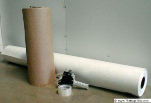 Wrap natural fiber rugs in PAPER – either brown kraft or white tyvek.