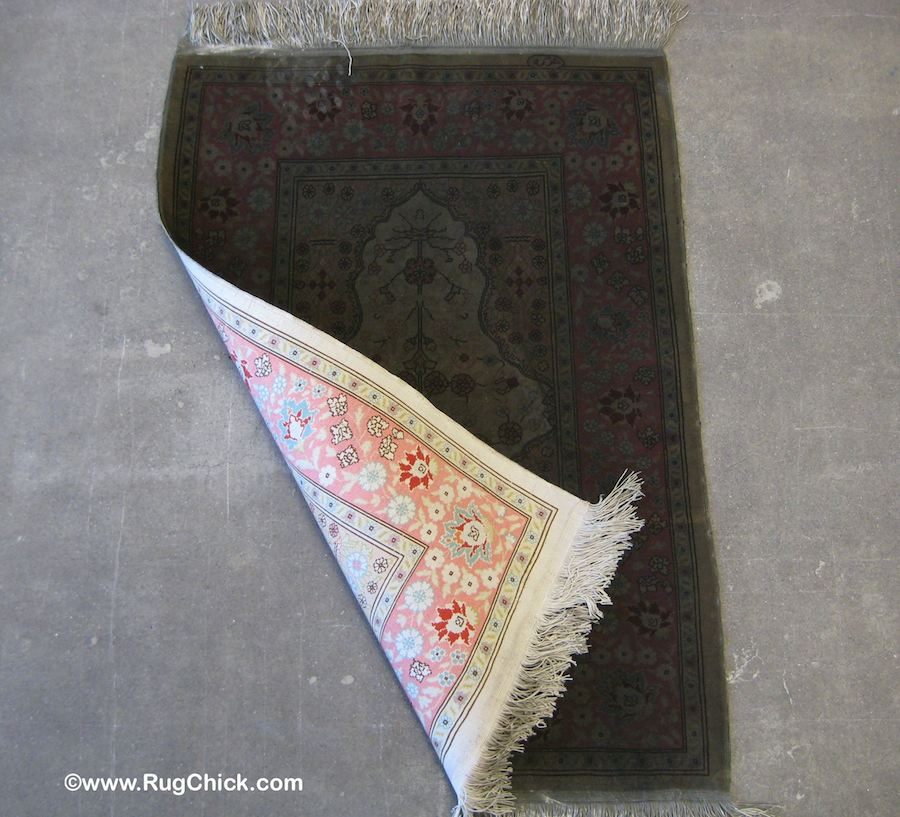 This Turkish Hereke silk rug was on a table in a home that burned down. Comparing the back to the front.