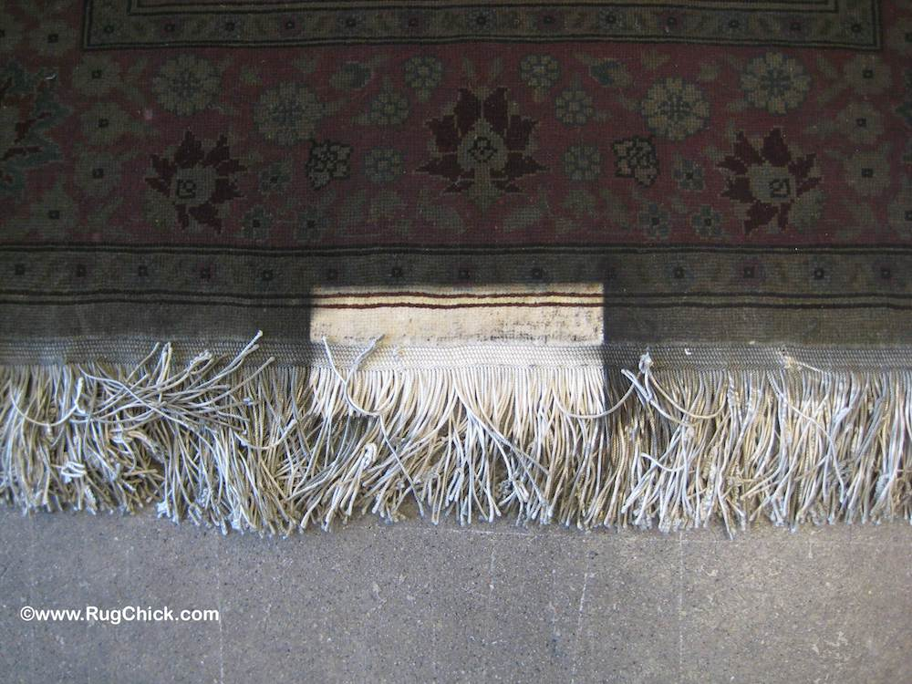 A heavy lamp on the edge of the rug created one small unaffected area.