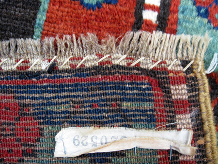Darning the end of a rug