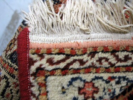 Do not machine repair a hand woven rug