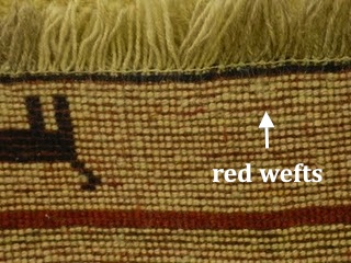 Red wefts on a Gabbeh rug