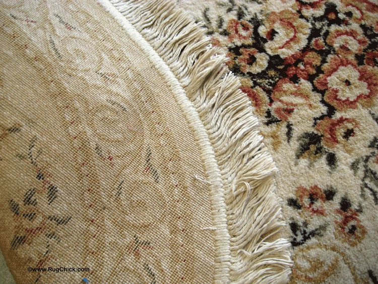 Back and front views of a synthetic rug