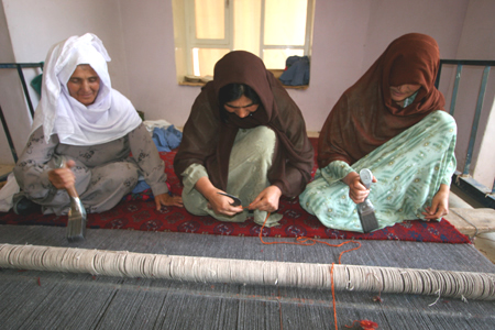 Afghan rug weaving project for women.