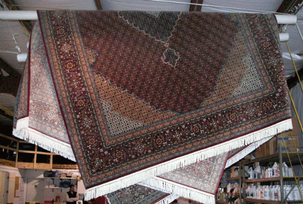 Hang rugs at an angle to lessen potential creasing.