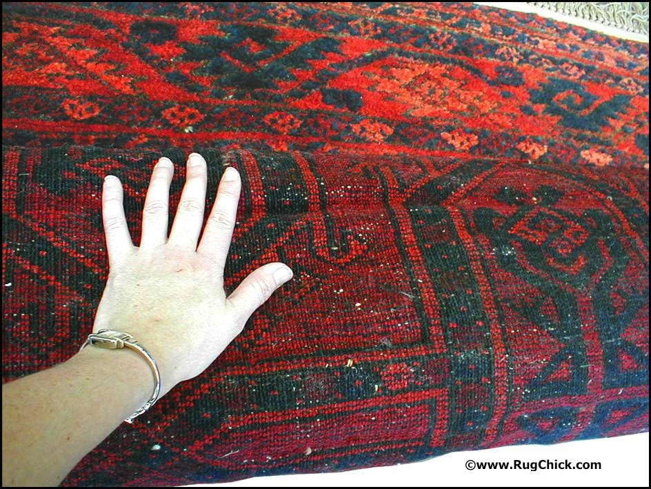 Creases can be clearly seen on the back of this Afghan rug. These are causing buckling on the front.