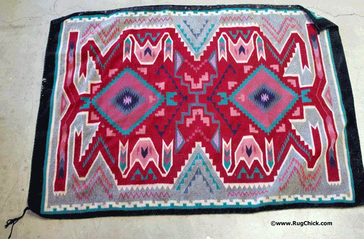 Navajo rug from a flood, the outside cords have shrunk creating a buckling of the rug.