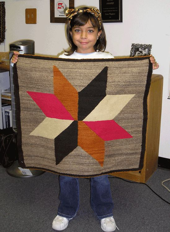 My niece Katie (when she was little) with a little Navajo weaving.