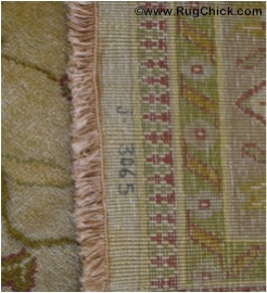 "Tea washed rug has beige fringe that is ""blotchy."""