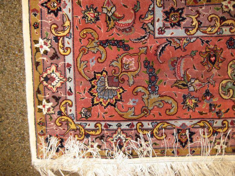 Tabriz hand woven wool rug.