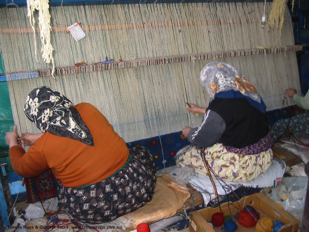 Photo by Temple Rugs & Cultural Tours, used with permission. 3 DOBAG weavers crafting a Turkish rug by hand.  www.templerugs.com.au