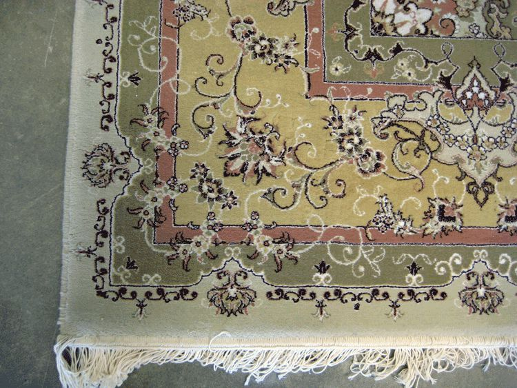 Acrylic machine made Tabriz design rug.