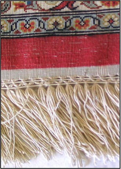 Quality silk rugs have a high knot count, vibrant colors, and a thin pile.